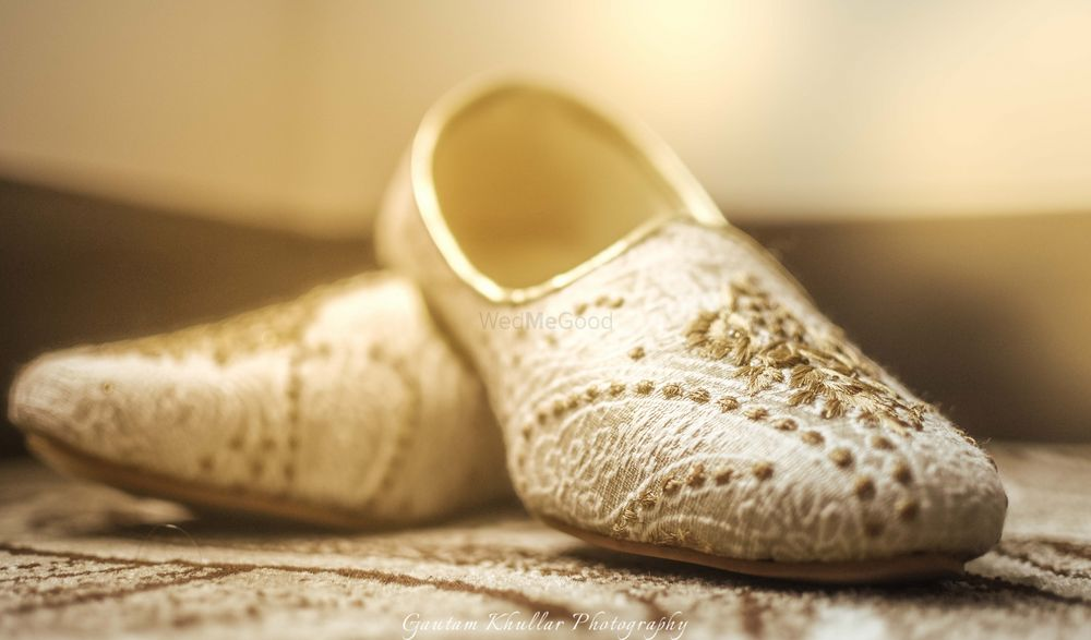 Photo of Cream Juttis with Gold Embroidery