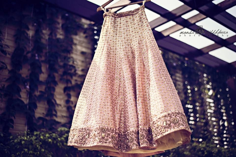 Photo of Cream and Gold Lehenga on a Hanger
