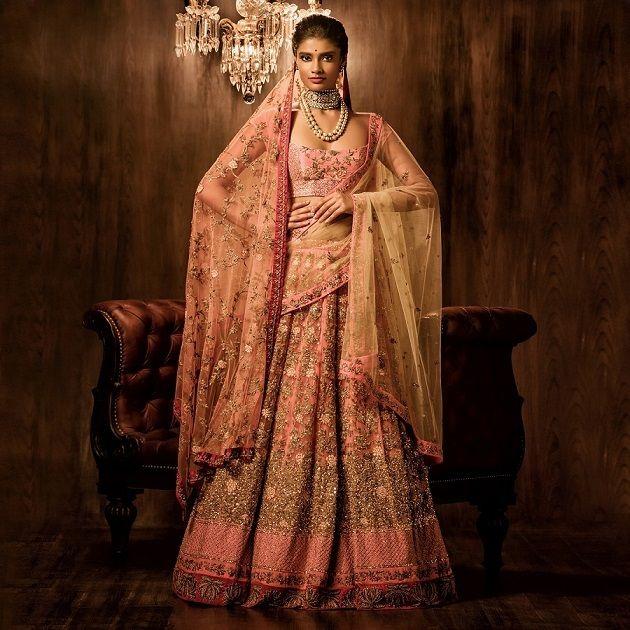Photo of light pink bridal lehenga