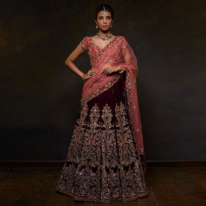 Photo of Bride in a maroon lehenga