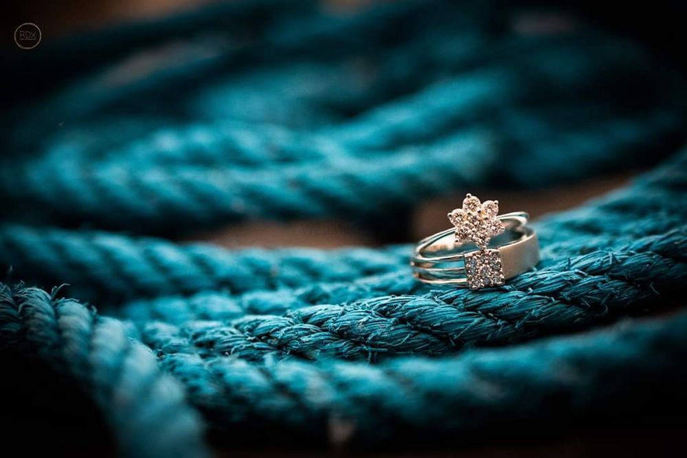 Photo of his and her engagement ring shot