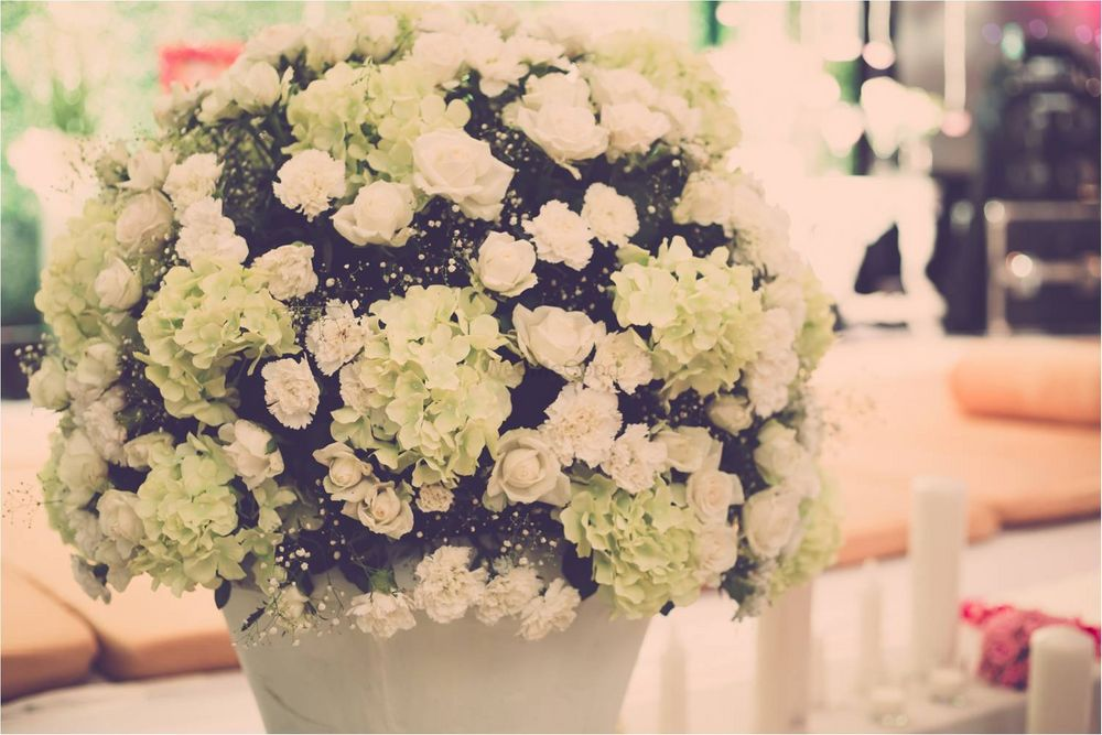 Photo of White Floral Table Centerpiece Decor