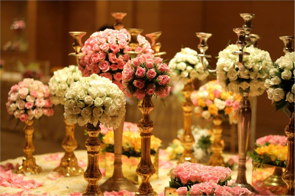 Photo of White Floral Table Centerpiece with Candelabras