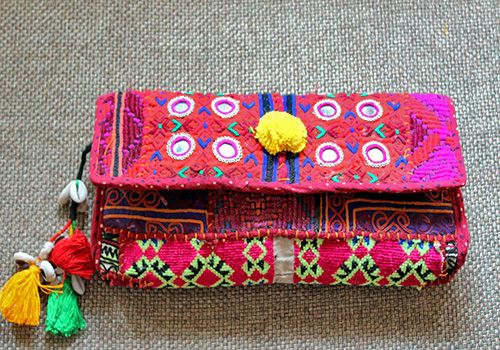 Photo of bright pink bridal clutch in fabric