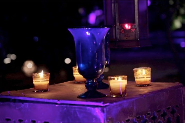 Photo of Blue Table Centerpiece with Candles Decor