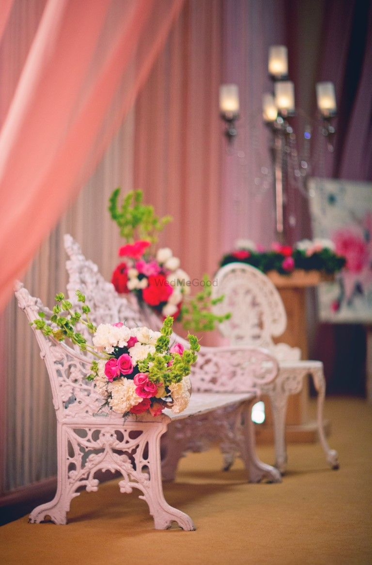 Photo of victorian white vintage chairs with flowers