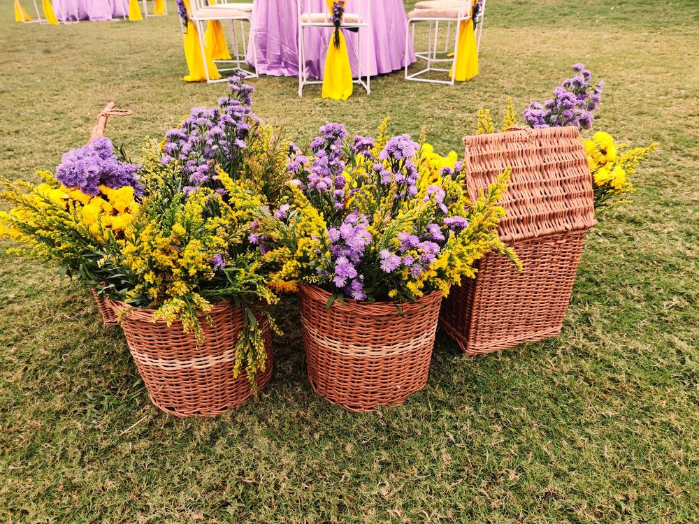 Photo of small intimate wedding decor with cane basket and florals
