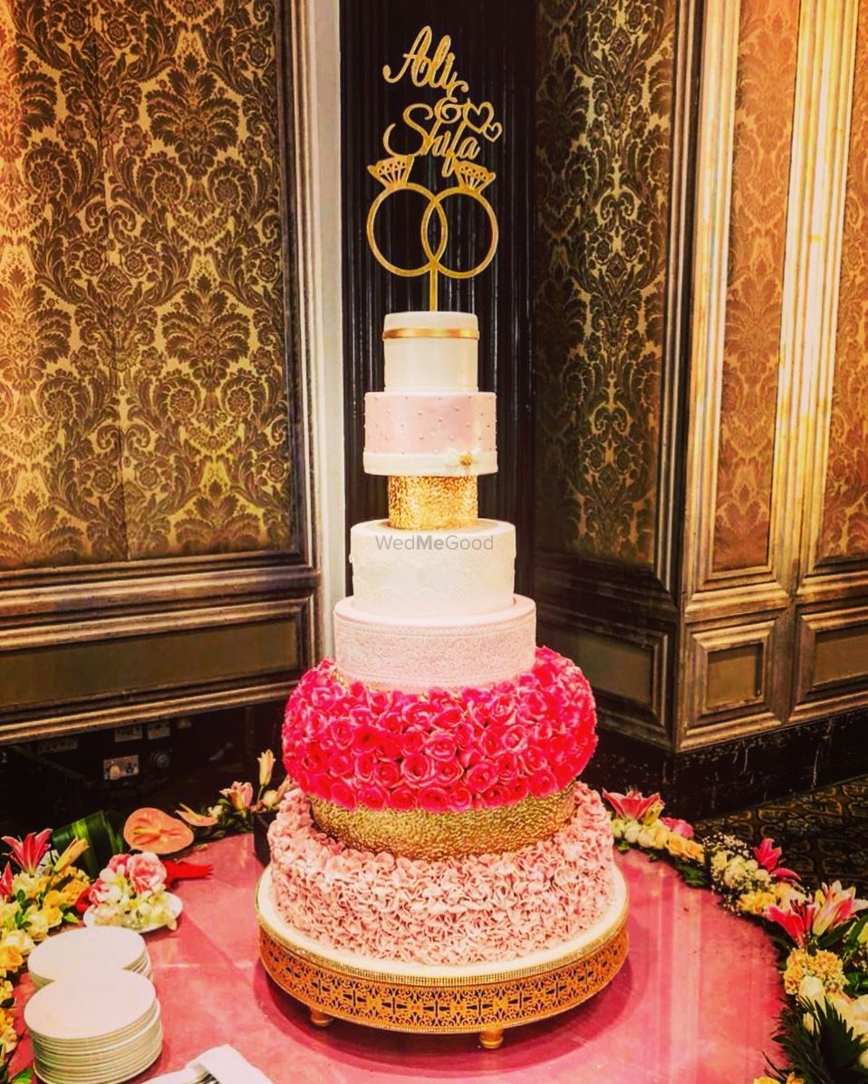 Photo of 7 tier cake with names on the top.