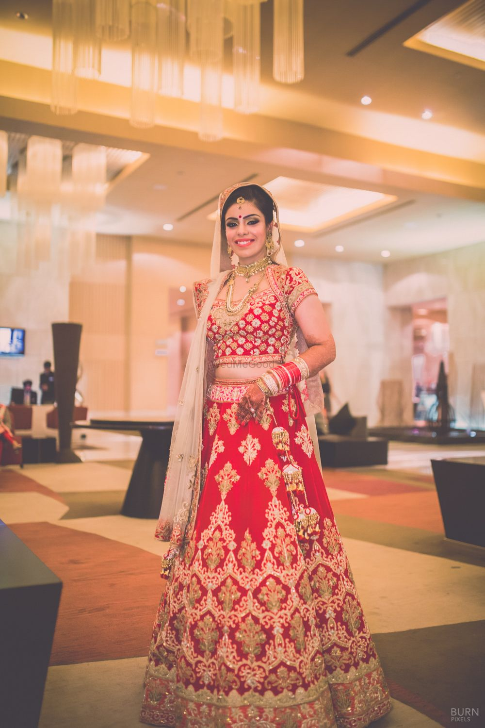 Photo of Red and Gold velvet Sequins Lehenga