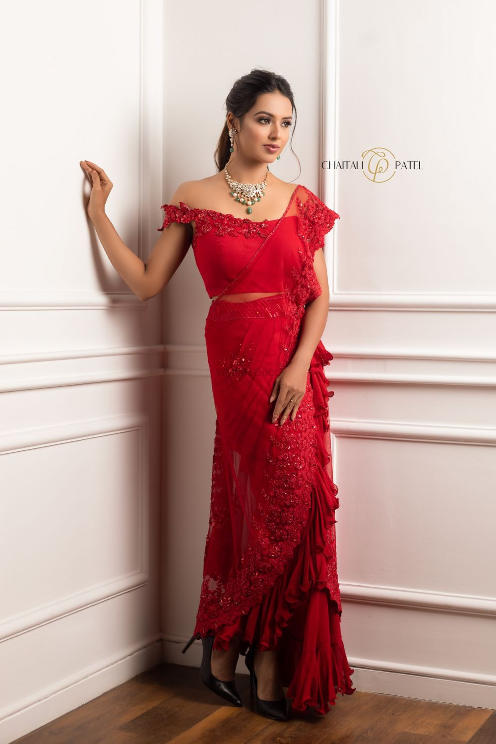 Photo of Ruffled sheer saree with an off shoulder blouse