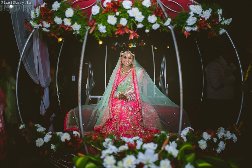 Photo of bride entrance in bird cage
