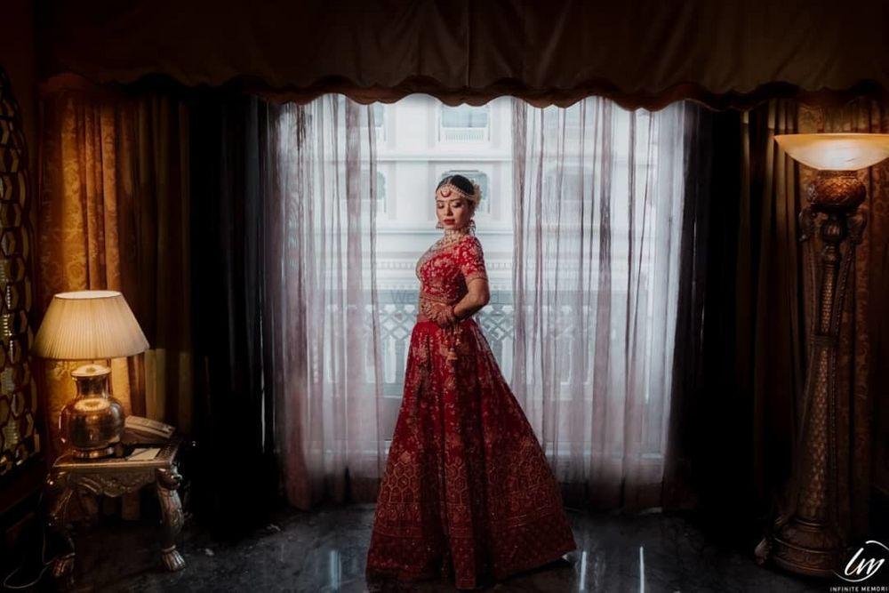 Photo of Red bridal lehenga with intricate details