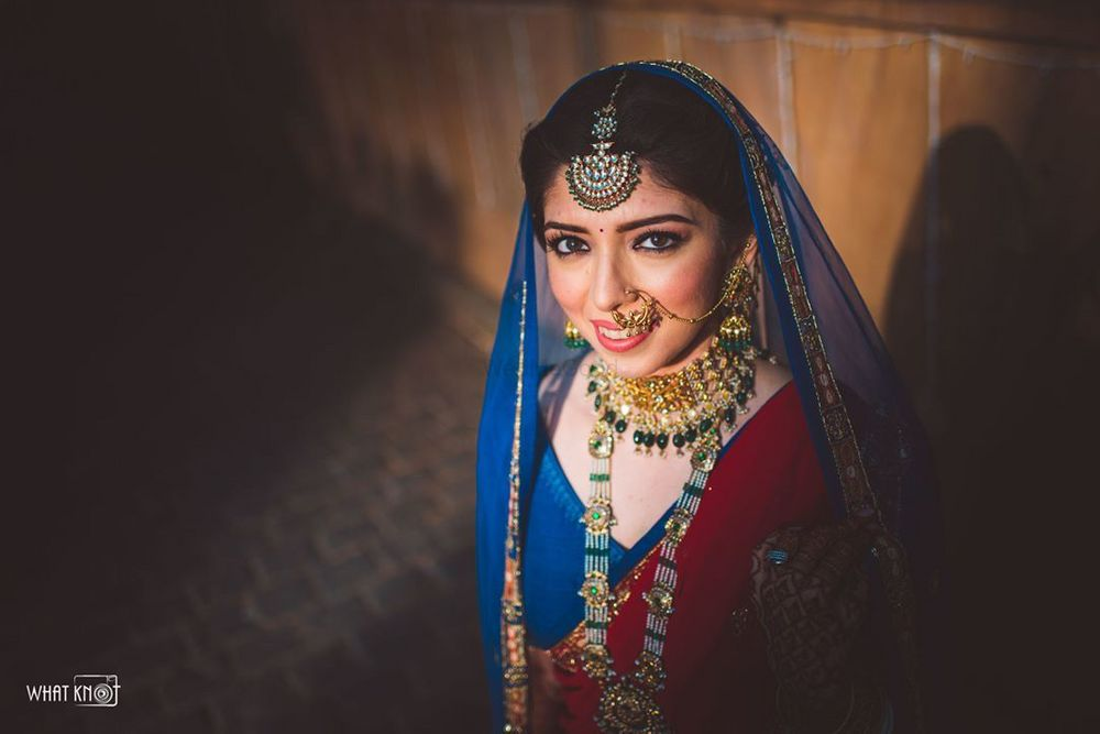 Photo of Bride dressed in a blue lehenga with a red dupatta