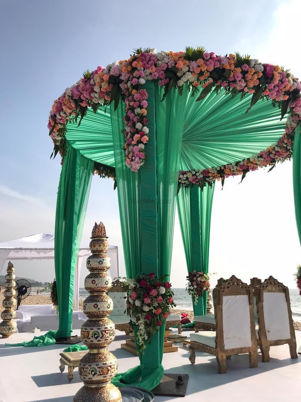 Photo of Beautiful beach side round mandap decor.