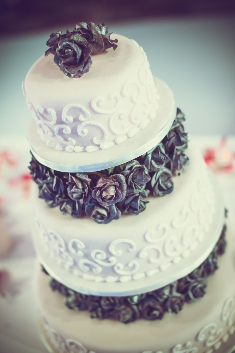Photo of White and Gray Cake Wedding Cake with Rosettes Decor