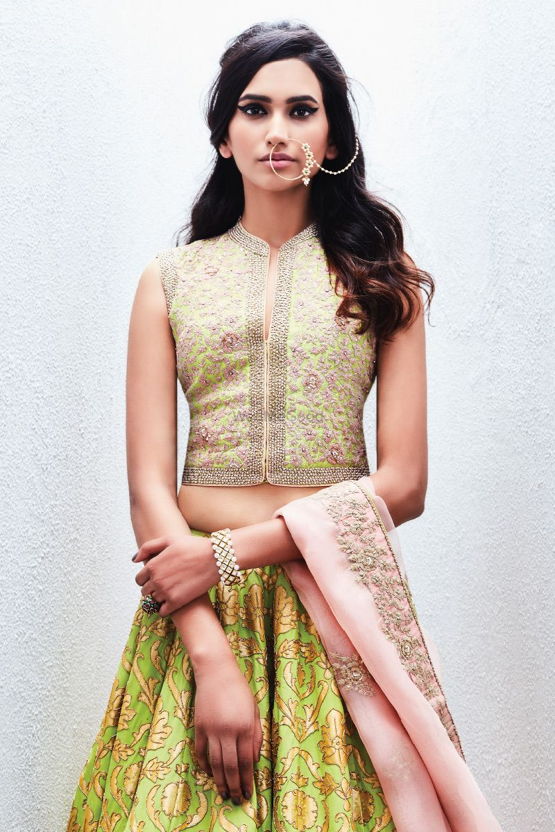 Photo of Light Green Sleeveless Blouse with Gold Embroidery