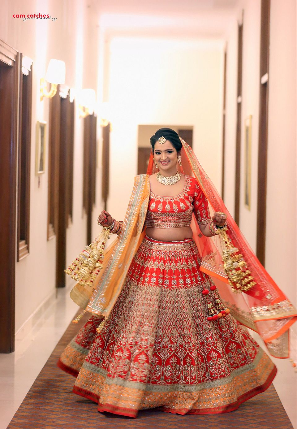 Photo of Bright Red and Gold Twirling Lehenga with Kaleere