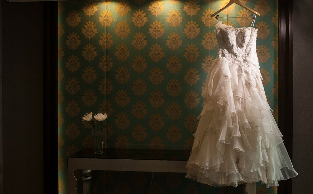 Photo of White Flared Wedding Gown on a Hanger