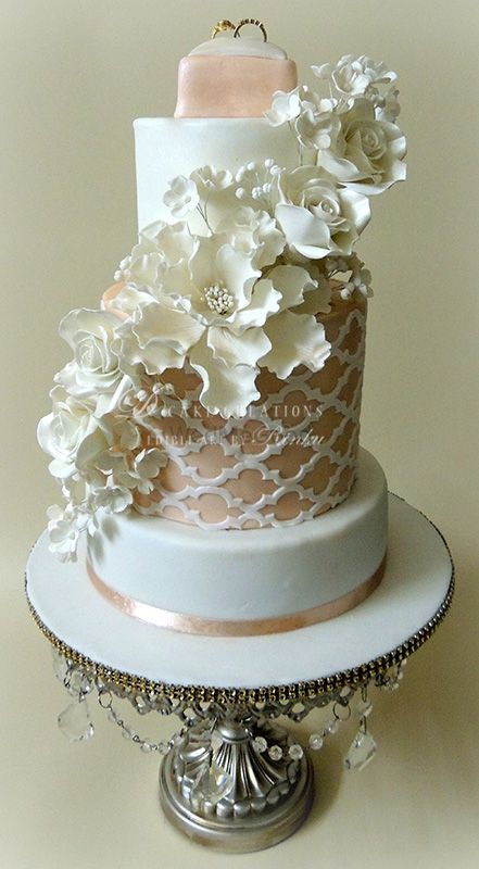 Photo of white and floral and peach wedding cake