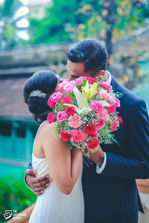 Photo of Christian wedding Couple Kissing Portrait