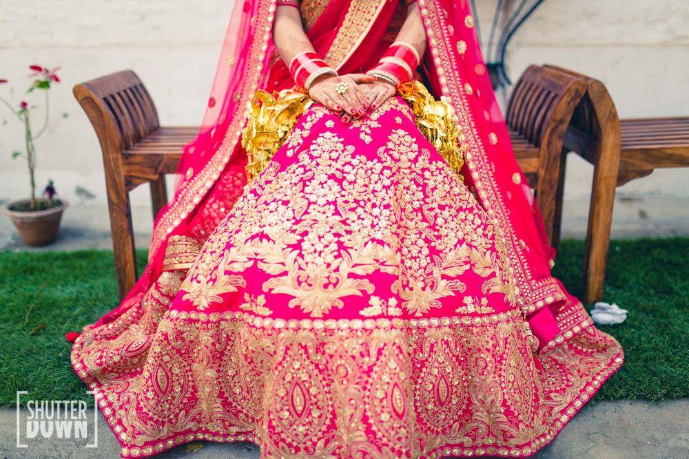 Photo of Hot Pink Bridal Lehenga with Gold Gota Work and Border