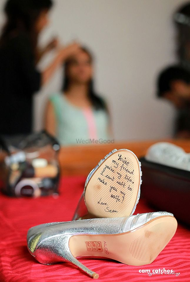 Photo of Love Message from Groom Under Bridal Shoe