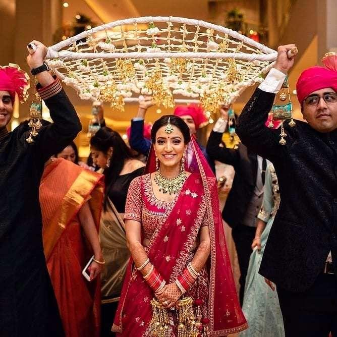 Photo of happy bridal entry.