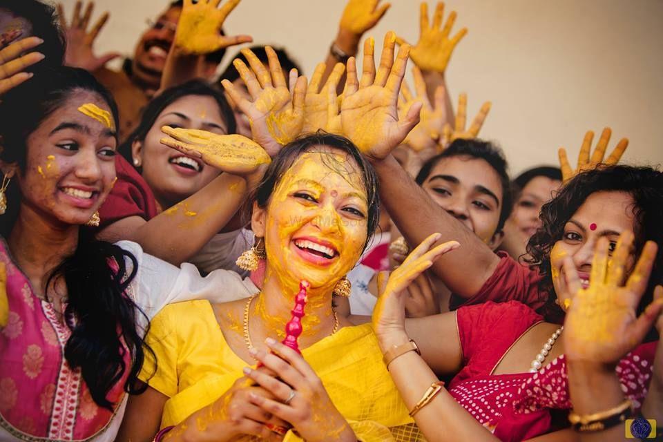 Photo of Fun haldi bridal party photo with bride