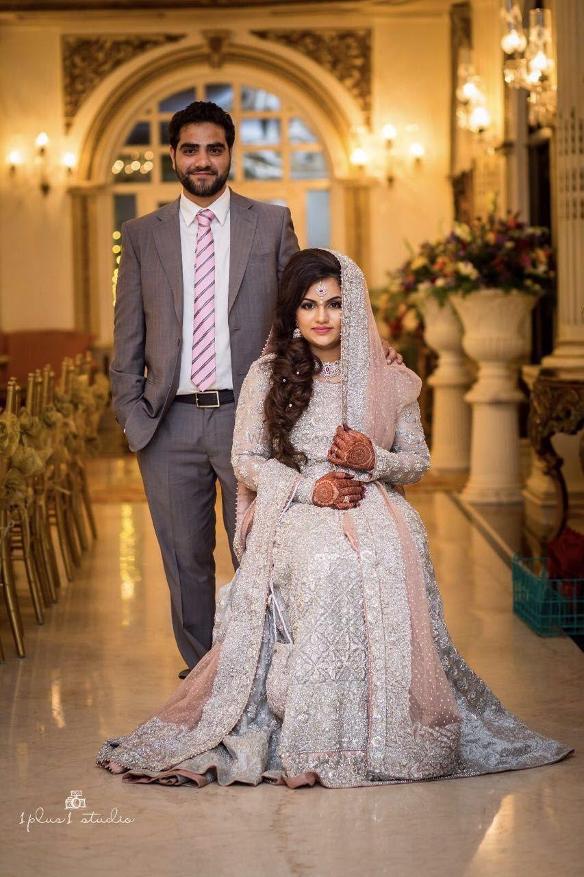 Photo of Muslim wedding couple portrait in grey