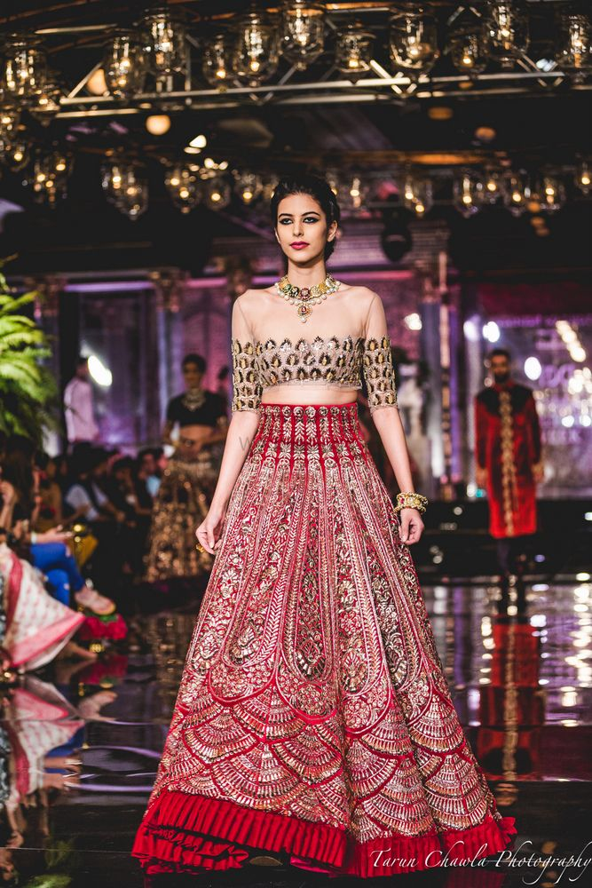 Photo of Red Lehenga with Silver Embroidery and Thread work