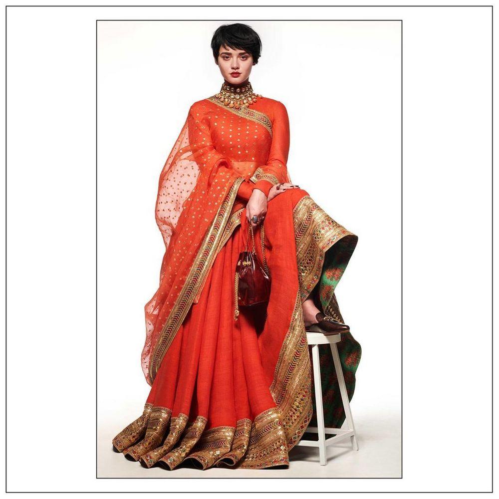 Photo of Madras Mehendi Bridal Lehenga Carried Beautifully with Sabyasachi Heritage Jewellery Collection.