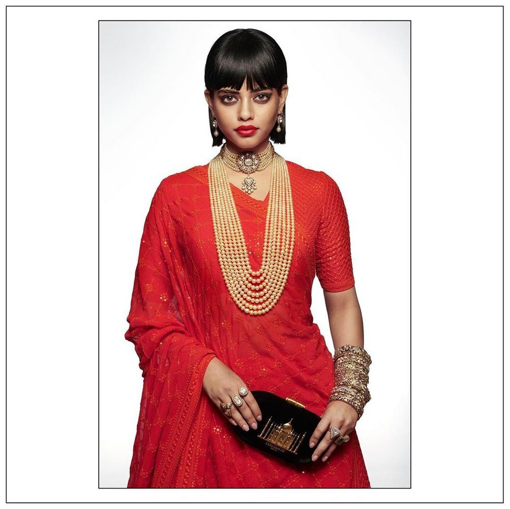 Photo of Red Heritage Bridal Lehenga Complimented with Sabyasachi Heritage Jewellery collection.