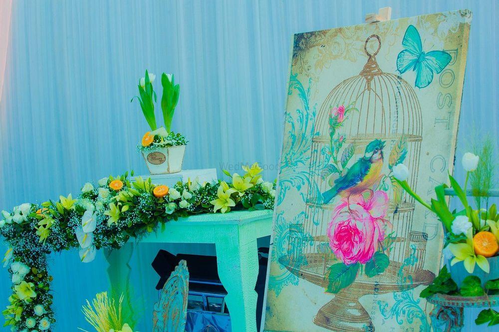 Photo of vintage aqua floral arrangement on table
