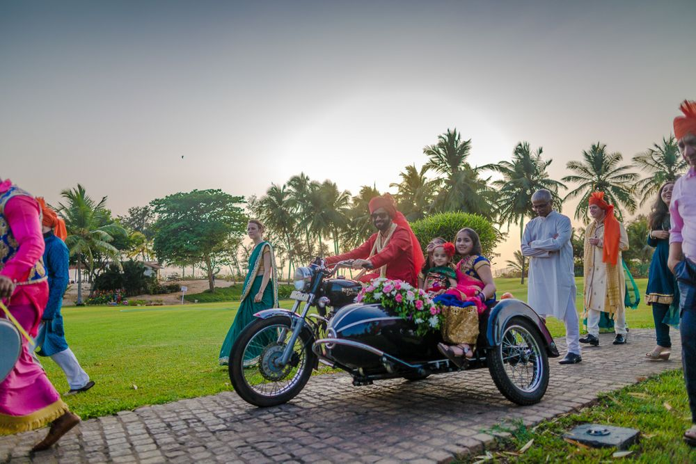 Photo of Groom Entering with Kids on a Vintage Motorcycle