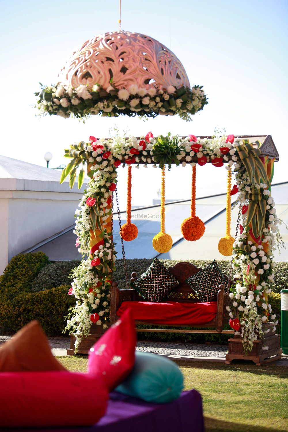 Photo of Colourful Mehendi Decor with Umbrella and Swing