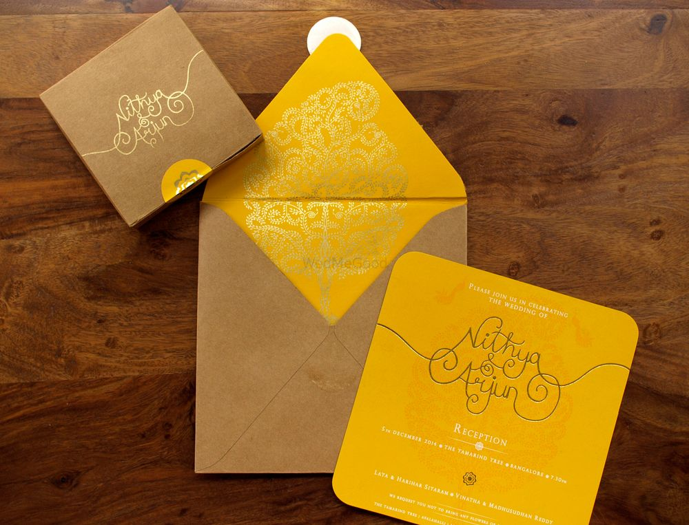 Photo of yellow and brown invitation cards