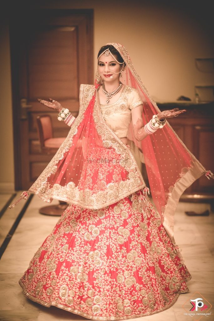Photo of Peach and Gold Lehenga with Floral Zardozi Work