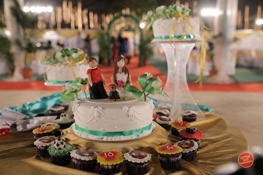 Photo of Single Tiered White Wedding Cake with Cupcake