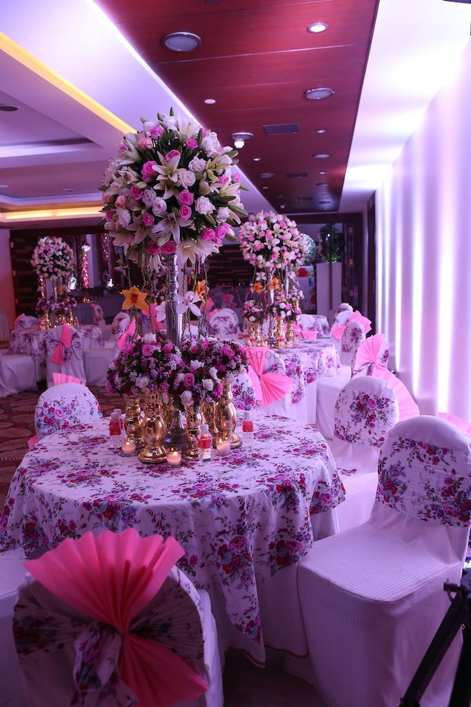 Photo of vintage english table centerpieces with floral print table linen