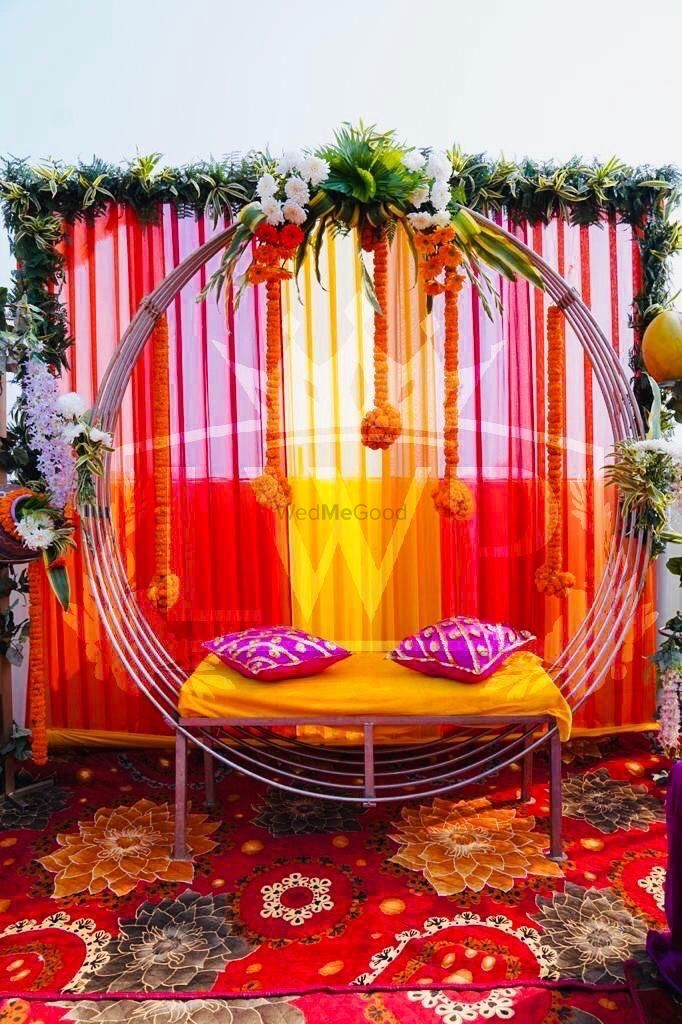Photo of Minimal Mehendi seating decor for a home function.
