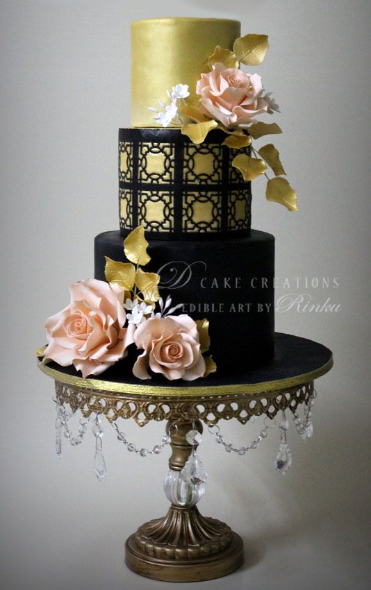 Photo of glamorous cocktail cake in black and gold with lace effect and pale pink roses with gold leaves