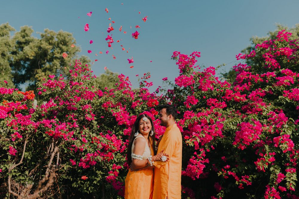 Photo of matching bride and groom in happy haldi photo