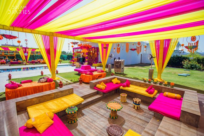 Photo of Pink and yellow themed mehendi decor.