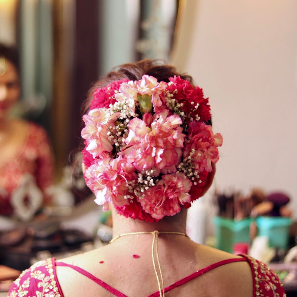 Photo of Bridal hairstyle with flowers