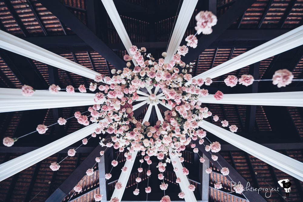 Photo of Ceiling decorated with a bunch of flowers.