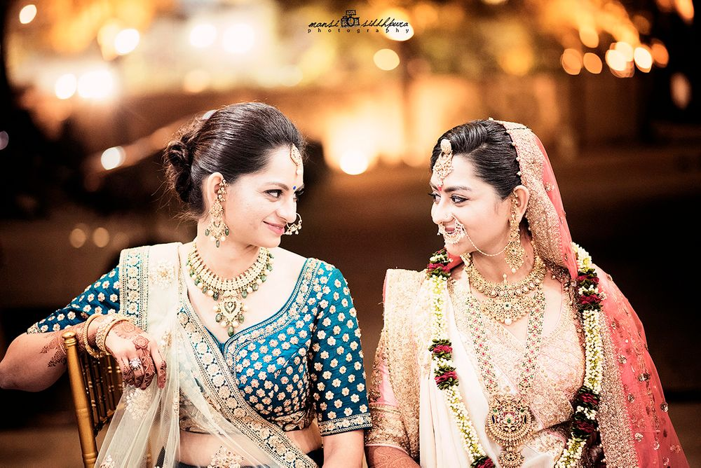 Photo of Bride with Sister on Wedding