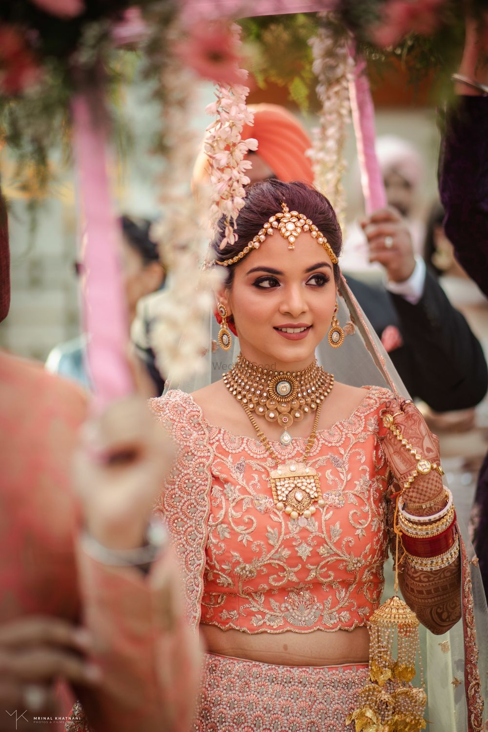 Photo of Candid shot of a bride during her entry.