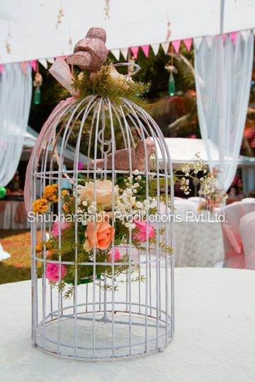 Photo of birdcage with roses inside