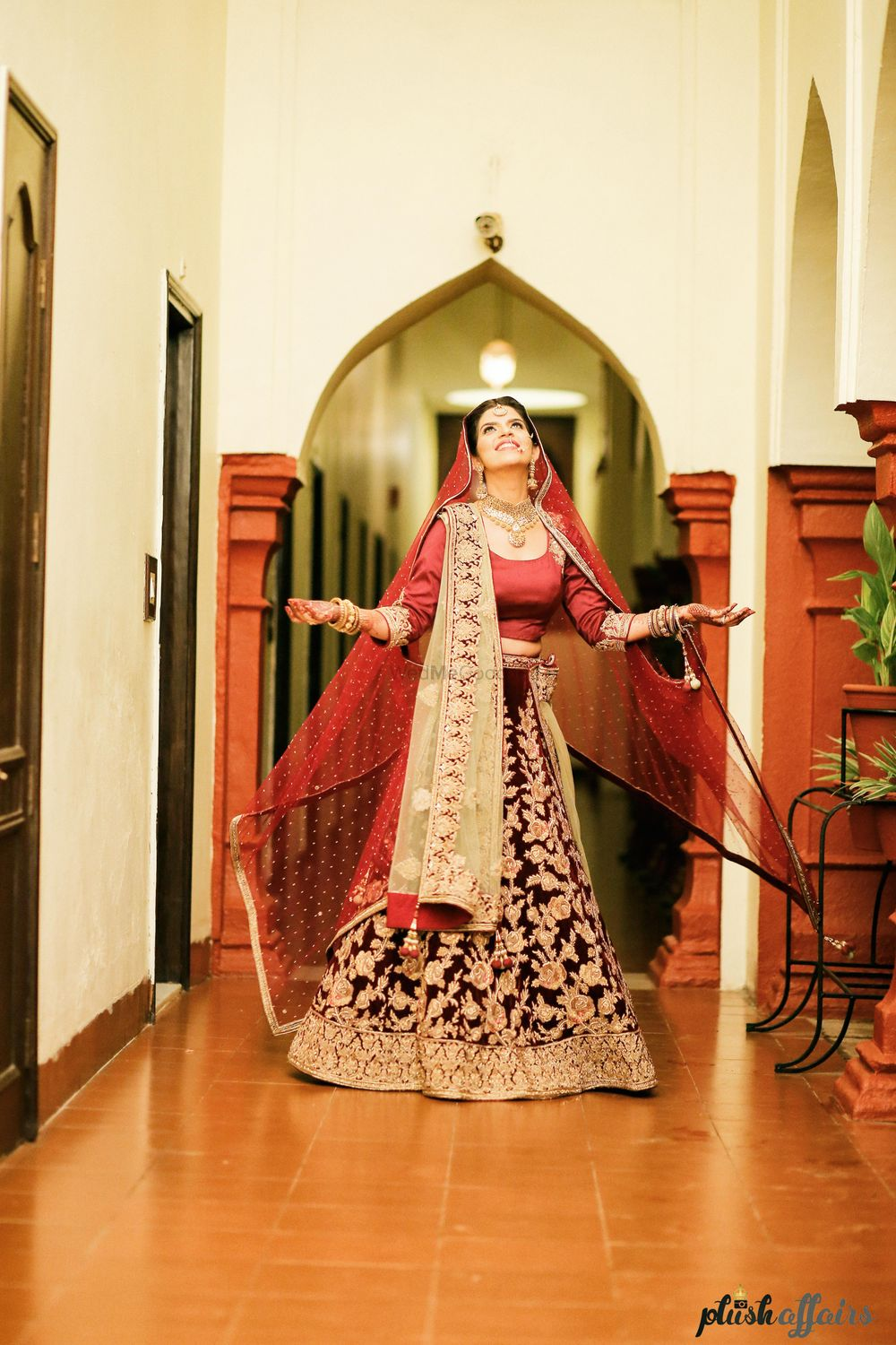 Photo of Plum Lehenga with Gold Floral Pattern and Maroon Blouse