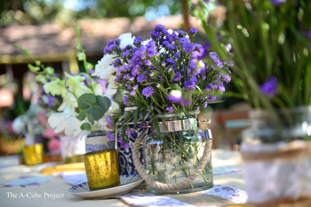 Photo of Mason jars filled with flowers used as a centrepiece.